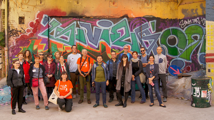 The participants of the 'Cosy Walk' with its leader, Mario Miličić, in the yard of the alternative-art center 'Medika' [GP 2019.]